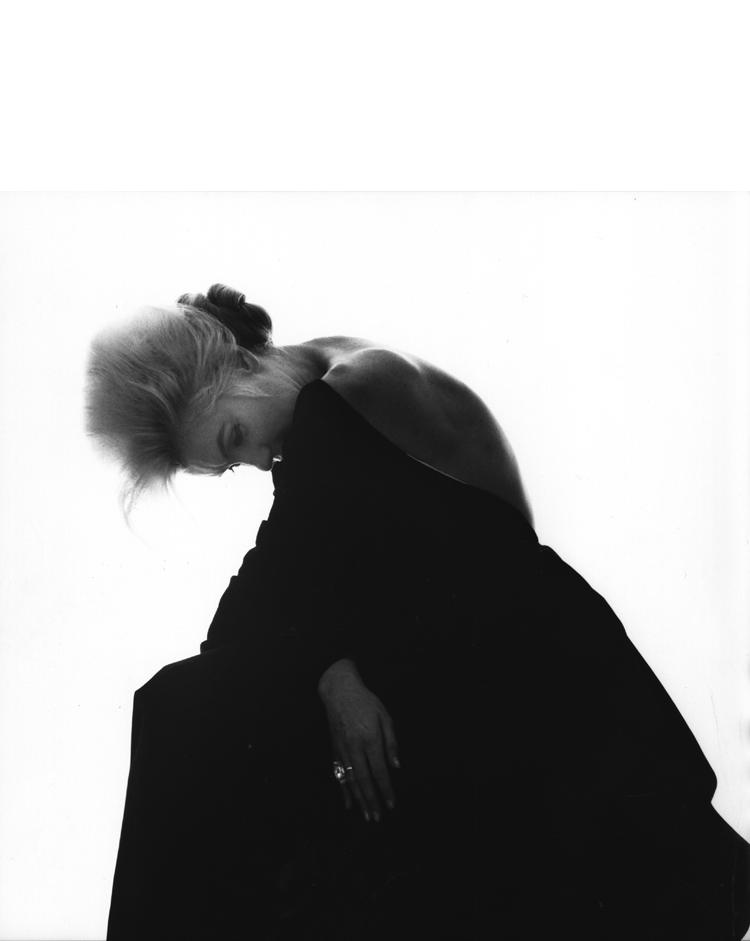 Marilyn Monroe modelling a black dress photographed by Bert Stern, June 1962