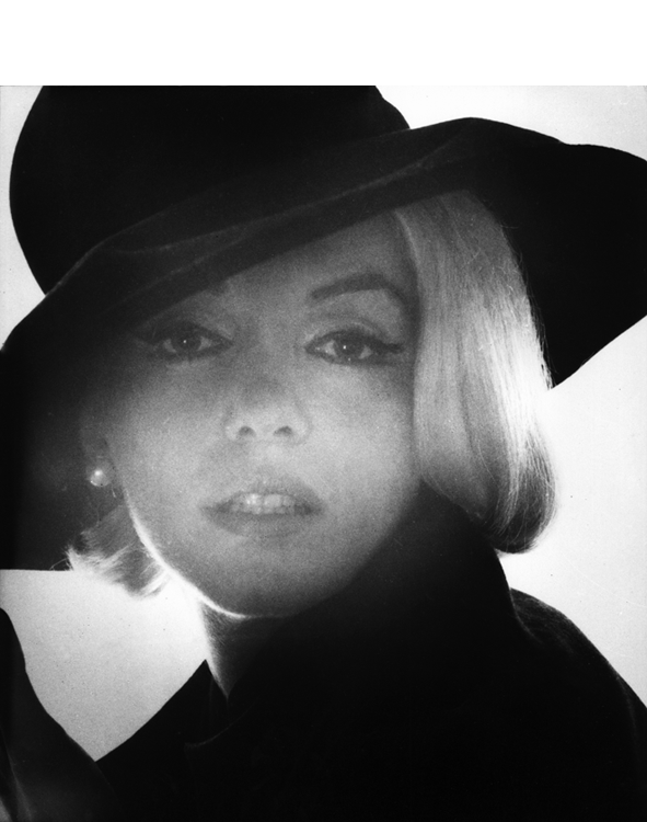 Marilyn Monroe wearing a black hat photographed by Bert Stern, June 1962