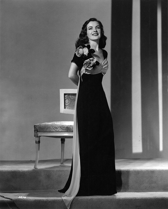 Ella Raines modelling a black crepe dress from Saks Fifth Avenue