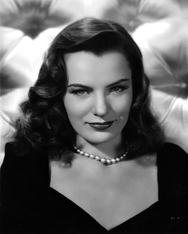 Ella Raines with a pearl necklace