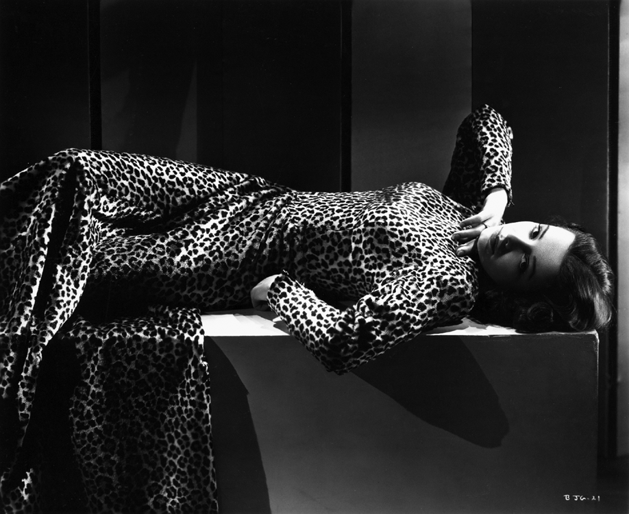 Jane Greer in a leopard-print gown
