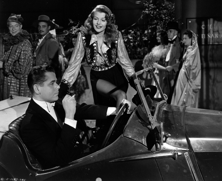 Gilda gets into the car with Johnny