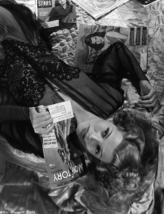 Cover girl Rita Hayworth with magazines