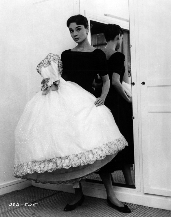 Audrey Hepburn holding a gown