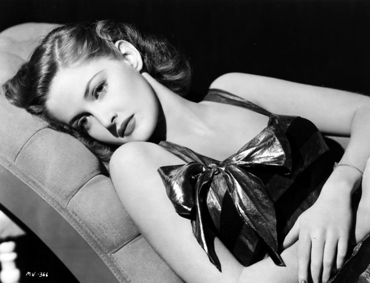Martha Vickers reclines in a lamé dress