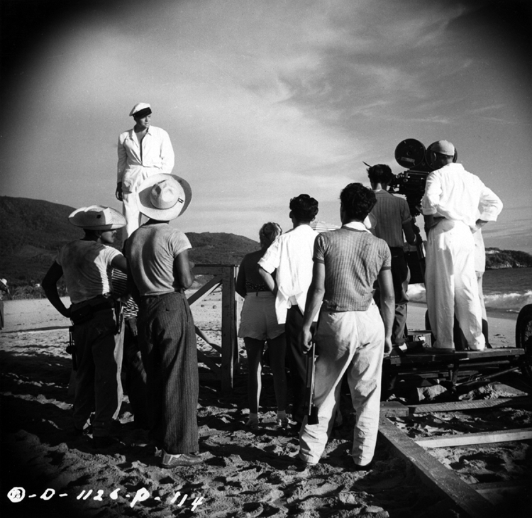 Orson Welles prepares to film a location scene for The Lady from Shanghai