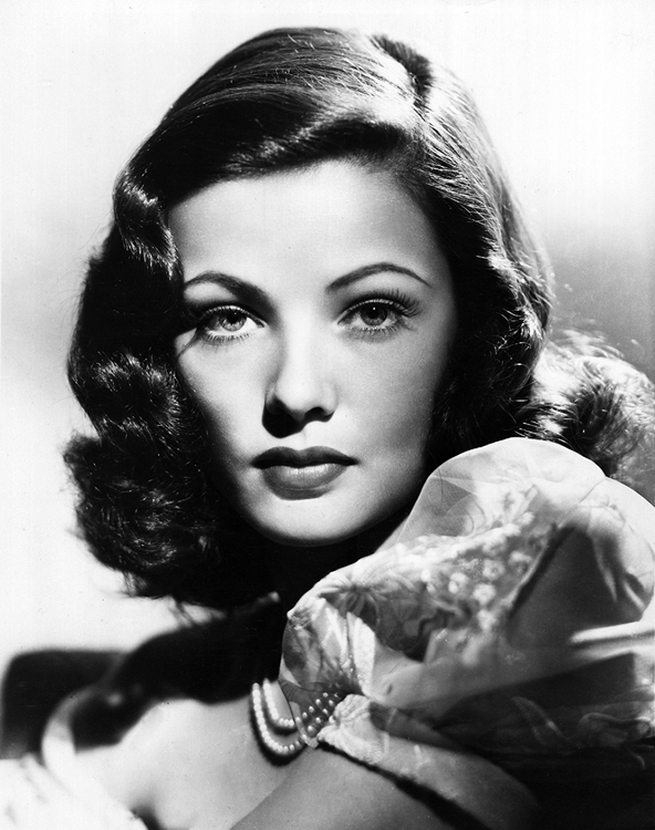 Gene Tierney glances over her shoulder.