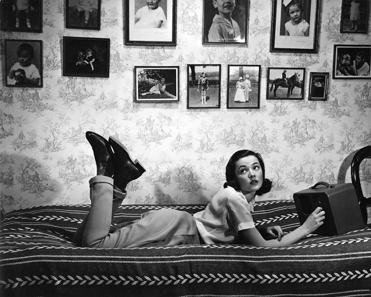 Gene Tierney in her bedroom at her parents' house.