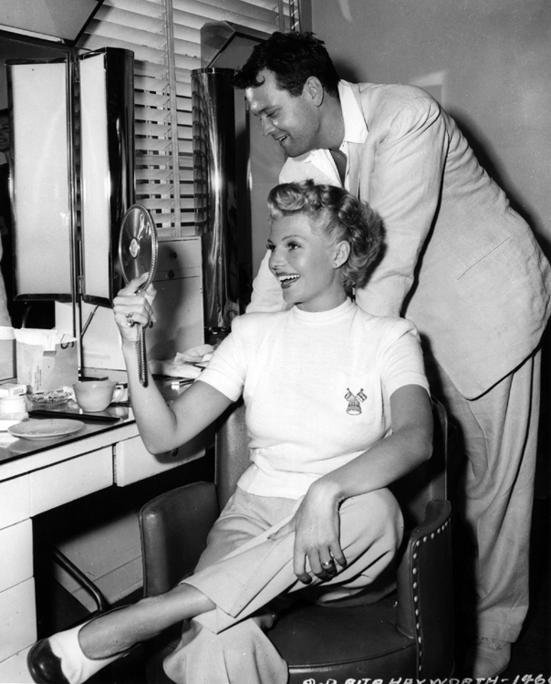 Orson Welles and Rita Hayworth admiring her million dollar haircut for The Lady from Shanghai