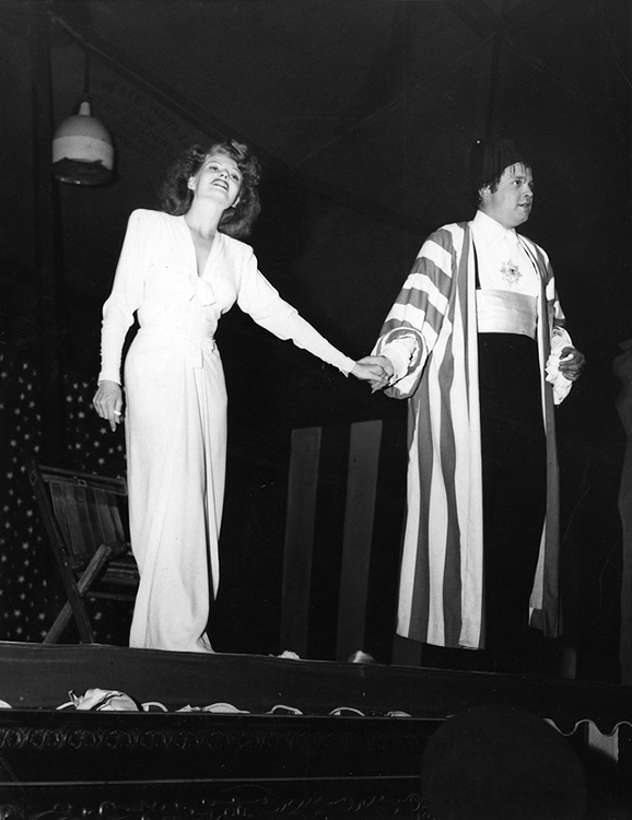Rita Hayworth and Orson Welles taking a bow in the big-top tent of his Wonder Show for Servicemen