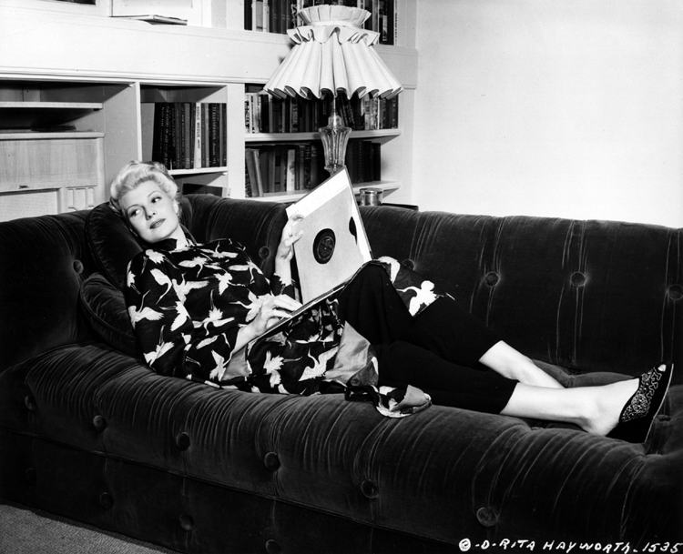 Rita Hayworth takes time to relax during the filming of The Lady from Shanghai
