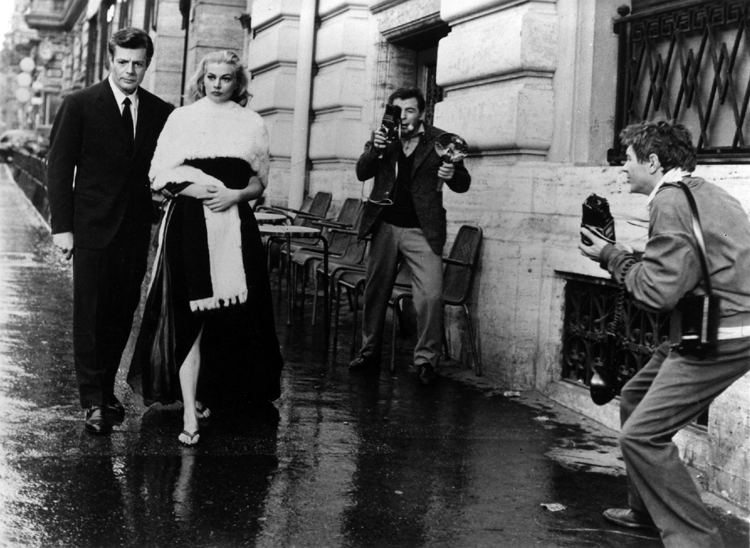 Marcello Mastroianni and Anita Ekberg pestered by paparazzi in Federico Fellini's La Dolce Vita