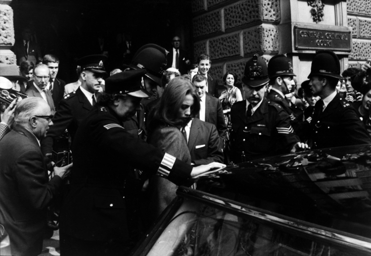 Christine Keeler surrounded by police and press