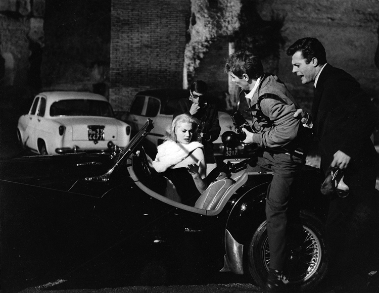 Marcello Mastroianni and Anita Ekberg again beset by paparazzi in Federico Fellini's La Dolce Vita