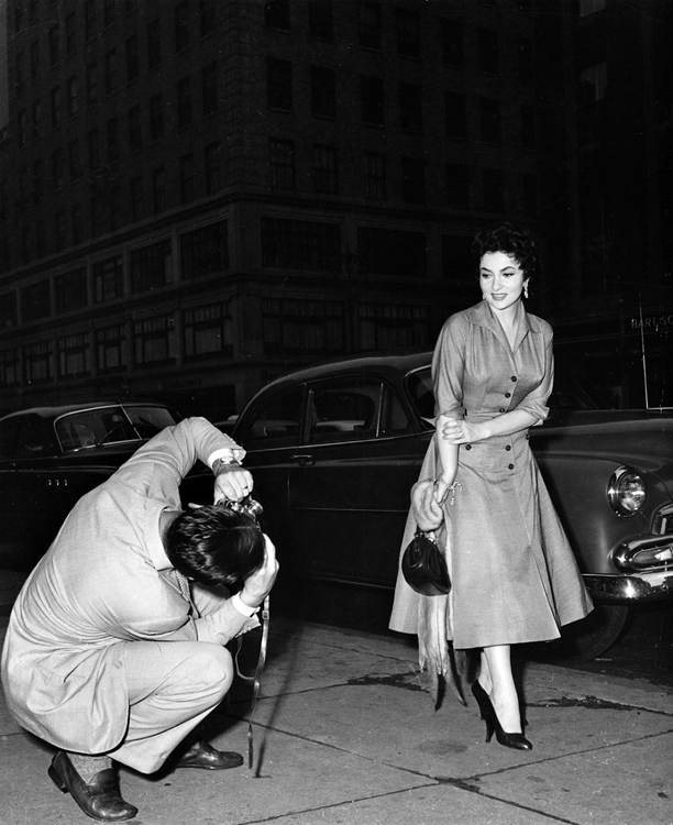 Gina Lollobrigida posing for a street photographer