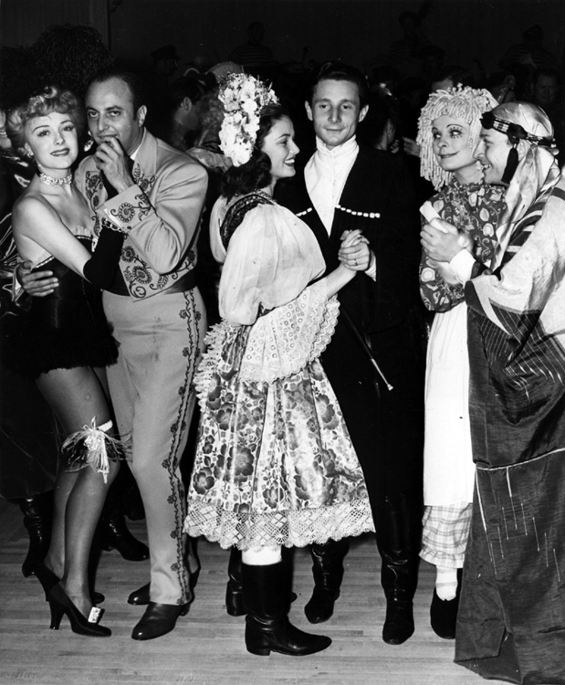 Gene Tierney and Oleg Cassini at a fancy-dress party