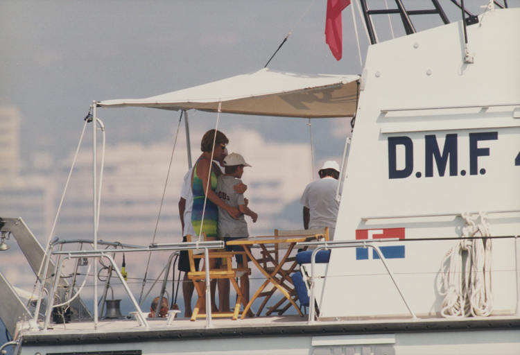 Princess Diana hugs her younger son Harry on board Mohamed Al-Fayed's luxury yacht, Jonikal