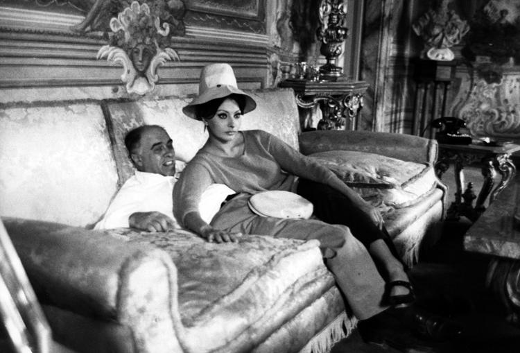 Sophia Loren and Carlo Ponti relaxing on a sofa
