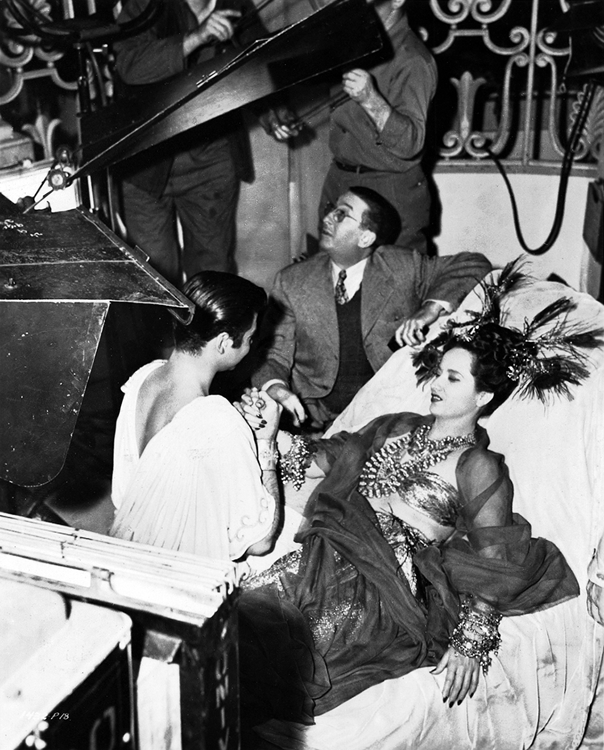 Merle Oberon and Turham Bey filming Night in Paradise