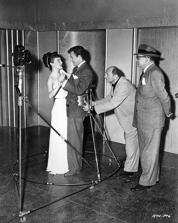 Franz Planer preparing to shoot a dancing scene starring Ava Gardner and Robert Walker