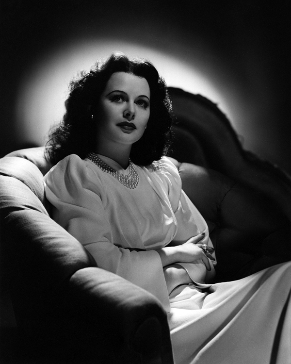 Hedy Lamarr relaxes in an armchair