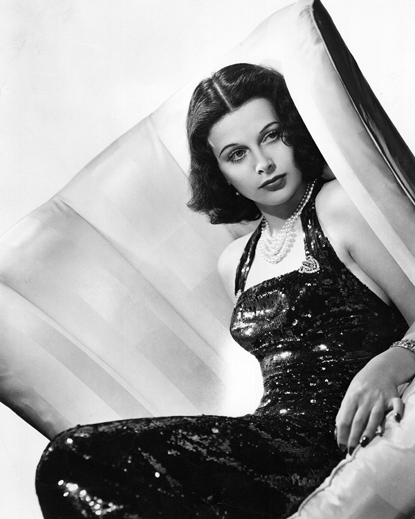 Hedy Lamarr wears a black sequin dress and pearls