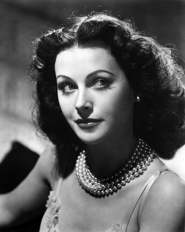Hedy Lamarr with a pearl necklace and earrings