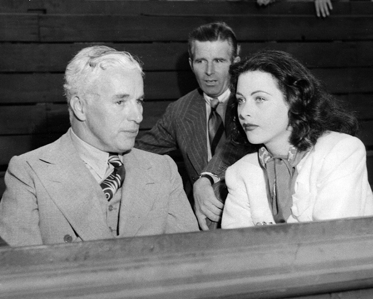Hedy Lamarr with Charlie Chaplin at the LA Tennis Club
