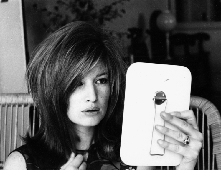 Monica Vitti looks at herself in the mirror