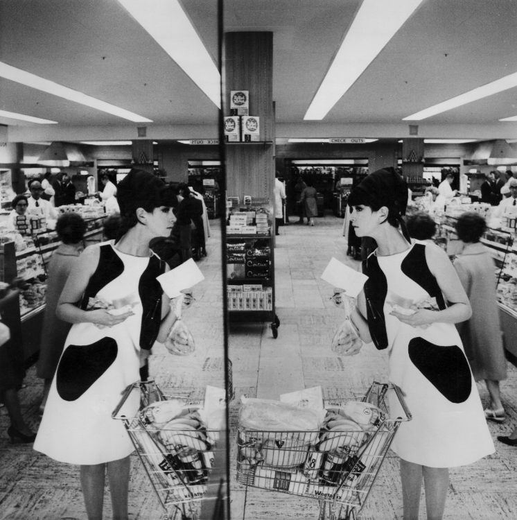 Model photographed in a supermarket by Norman Parkinson