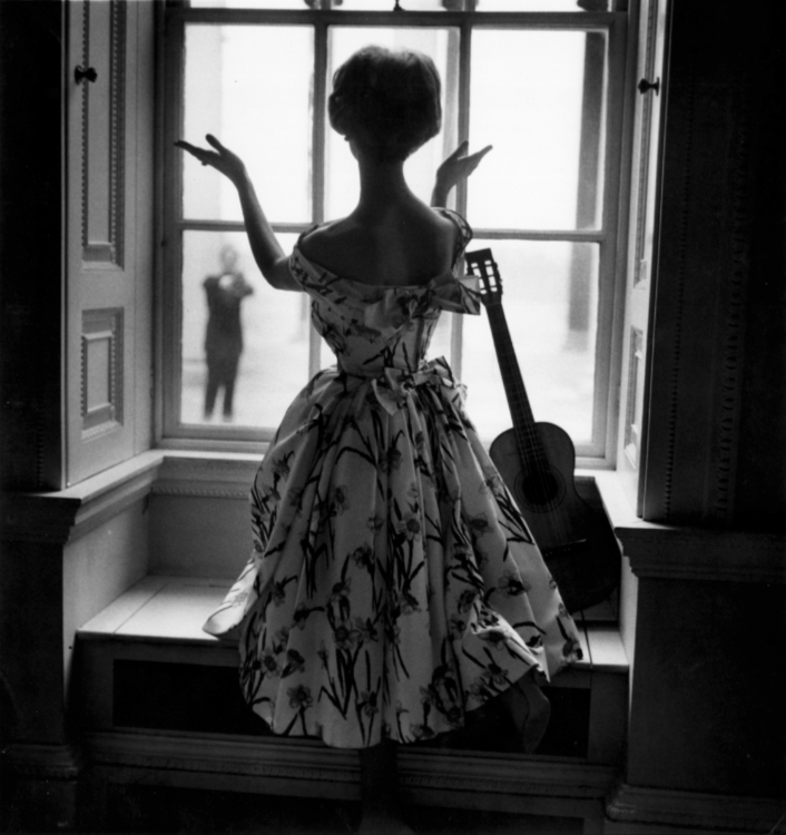 Pagan Grigg, silhouetted in front of a window, photographed by Norman Parkinson