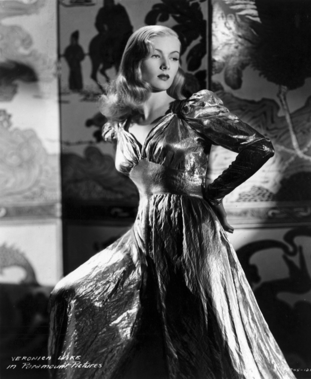 Veronica Lake poses in a lamé gown