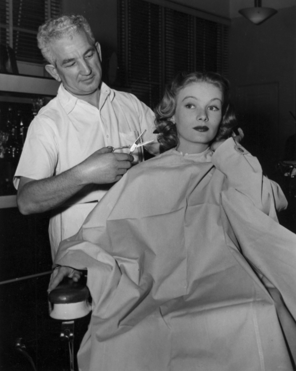 Veronica Lake has her hair styled by Victor Honig