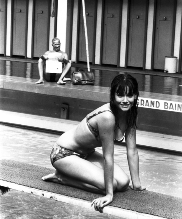 Claudine Auger poses on a diving board