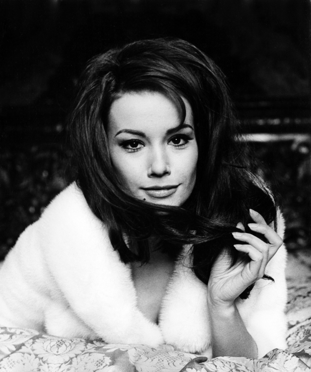 Claudine Auger wrapped in fur
