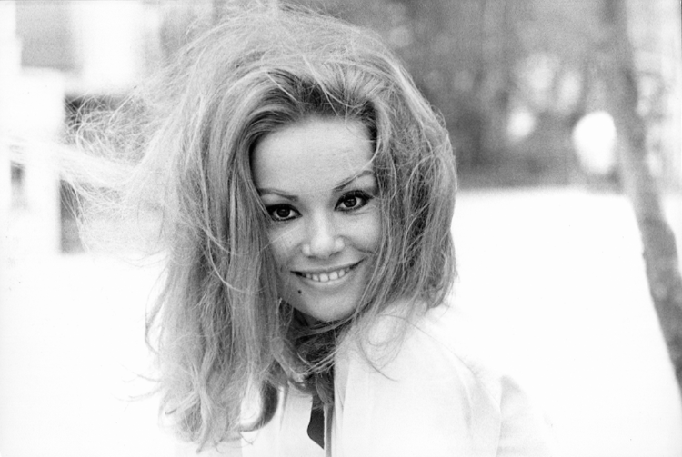 Claudine Auger smiling broadly