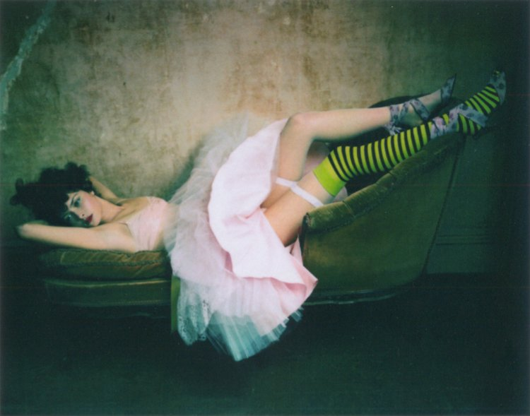 Tasha Tilberg reclining on a chaise longue by Paolo Roversi