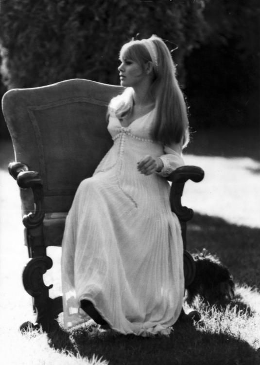 Britt Ekland seated in an armchair in her garden in Rome