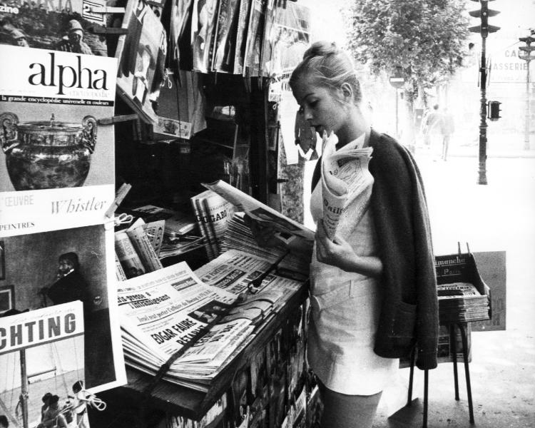 Ewa Aulin at a newspaper kiosk in France