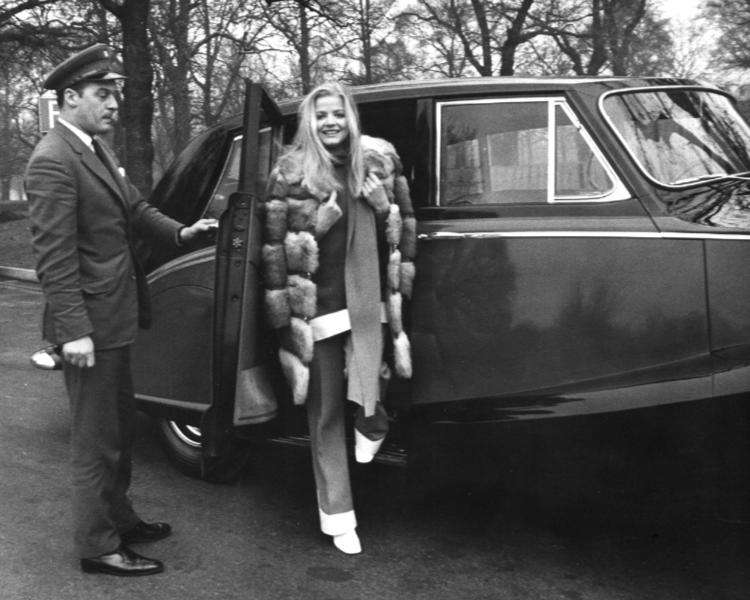 Ewa Aulin getting out of a Rolls Royce